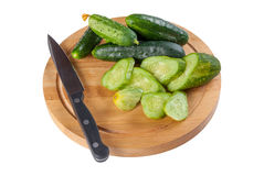 Whole and sliced green cucumbers Royalty Free Stock Image