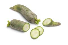 Whole and sliced green radish Stock Image