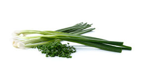 Whole and sliced green spring onion on white Stock Photo