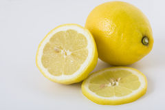 Whole and sliced lemons Royalty Free Stock Photo