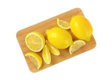 Whole and sliced lemons Royalty Free Stock Image