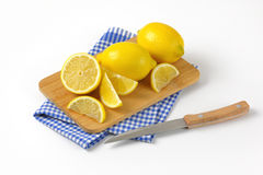 Whole and sliced lemons Royalty Free Stock Images