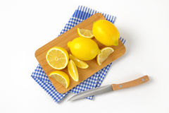 Whole and sliced lemons Royalty Free Stock Photography