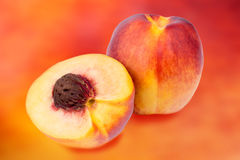 Whole and sliced nectarine Stock Photography