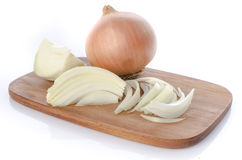Whole and sliced onions on a cutting board Stock Image