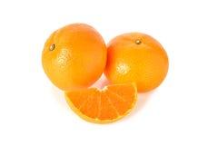 Whole and sliced orange on white Stock Image