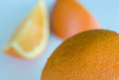 Whole and sliced oranges. Macro view of whole and sliced oranges with studio background Stock Photo
