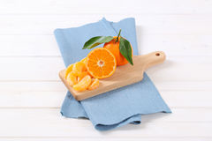 Whole and sliced oranges Royalty Free Stock Photos