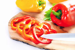 Whole and sliced peppers, red and yellow pepper. Raw vegetable. Stock Photo