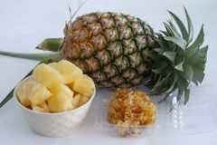 Whole, sliced piece and preserved pineapple isolated on white background. stock images