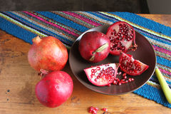 Whole and Sliced Pomegranates Stock Photo