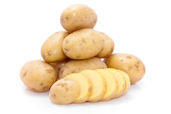 Whole and sliced potatoes Stock Photo