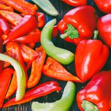 Whole and sliced red and green bell pepper Royalty Free Stock Image