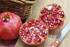 Whole and Sliced Ripe Pomegranates Stock Photography