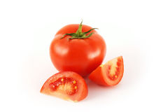 Whole and sliced ripe tomato Stock Images