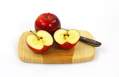Whole and Sliced Rome Apples Stock Images