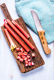 Whole and sliced steams of fresh rhubarb. Vibrant colors. From above on wooden table Stock Photography
