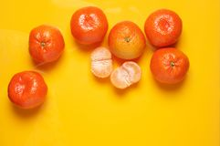 Tangerines on yellow background stock photography