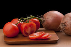 Whole and sliced tomatoes. Stock Image