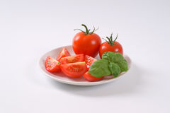 Whole and sliced tomatoes Royalty Free Stock Images
