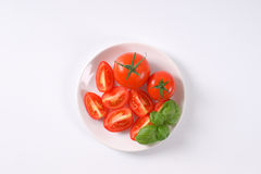 Whole and sliced tomatoes Stock Image