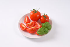 Whole and sliced tomatoes Stock Photo