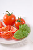 Whole and sliced tomatoes Stock Images