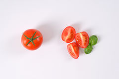 Whole and sliced tomatoes Stock Photos