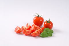 Whole and sliced tomatoes Royalty Free Stock Photography