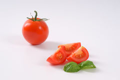 Whole and sliced tomatoes Royalty Free Stock Photos