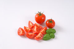 Whole and sliced tomatoes Stock Photography