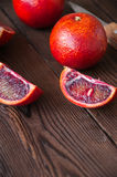 Whole and slices of blood oranges stock photos