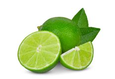 Whole and slices green lime with green leaf isolated on white. Background royalty free stock photos
