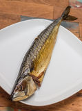 Whole smoked mackerel on a wooden table Royalty Free Stock Photos