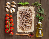 Whole spelt pasta, vegetables,  herbs and olive oil Royalty Free Stock Photos
