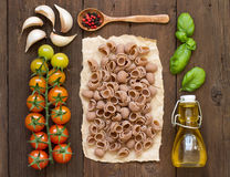 Whole spelt pasta, vegetables,  herbs and olive oil Stock Photo