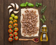 Whole spelt pasta, vegetables,  herbs and olive oil Stock Photos