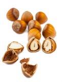 Whole and split hazelnuts Royalty Free Stock Photos