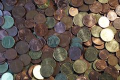 A packet of euro cent coins. A whole stack and packet of different euro cent coins stock image