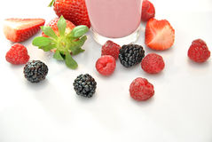 Whole strawberries, blackberries and raspberries Royalty Free Stock Photos
