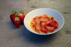 Whole strawberries, chopped with orange juice and wooden background. Whole strawberries, chopped with orange juice wooden background stock photos