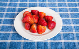 Whole Strawberries on White Plate Stock Photography