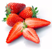 The whole strawberry and half Stock Images