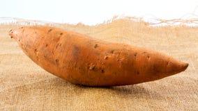 Whole sweet potato on burlap Royalty Free Stock Photography