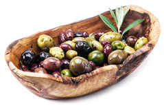 Whole table olives in the wooden bowl. Stock Image