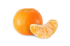 Whole tangerine fruits and peeled segment isolated. On white background Stock Images