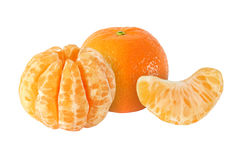 Whole tangerine fruits and peeled segments isolated. On white background Stock Photos