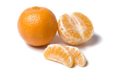 Whole tangerine, half and wedges Stock Photography