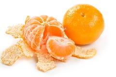 Whole  tangerine and peeled mandarin Stock Image