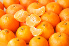 Whole tangerines and tangerine slices Stock Photo